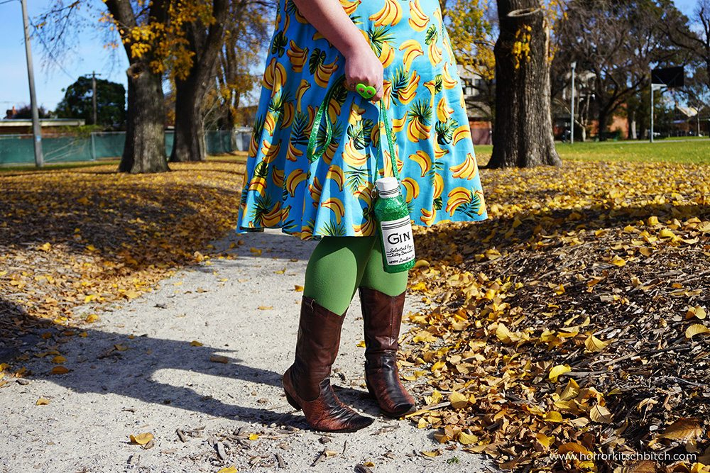 Kobi Jae of plus size fashion blog Horror Kitsch Bitch in a blue vintage-styled retro dress covered in bananas from Lady V London's plus size range - Lady Voluptuous.